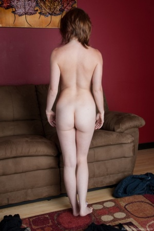 Cute redhead Zia drops her jeans and stretches wide open to show a ginger muff