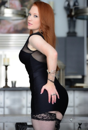 Natural redhead Lucy OHara sticks a dildo in her twat wearing mesh stockings