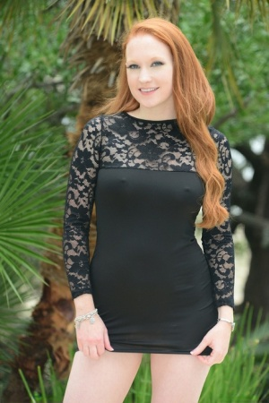 Redhead MILF Lucy OHara hikes her dress to ride Sybian like sex toy by pool