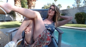 Dirty blonde Amber Hahn frees big tits from USA styled dress wearing glasses
