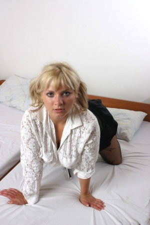 Busty blonde Malina May masturbates on her bed in crotchless pantyhose 94766958