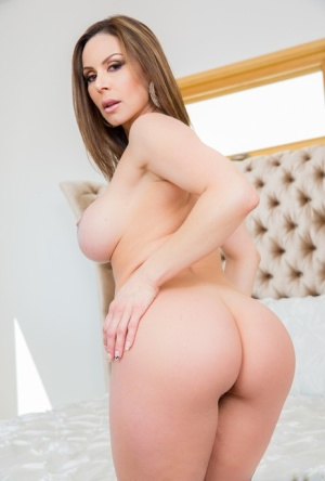 Curvy female Kendra Lust works free of a revealing bodystocking before sex 54560750