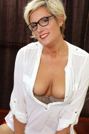 Over 30 businesswoman Diamond Fontaine looks over her glasses after disrobing 56705118