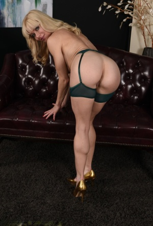 Over 30 blonde Serene Siren doffs a lingerie ensemble to pose in the nude 76424098