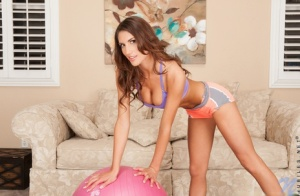 Fit teen girl August Ames spreads her pussy lips after a workout session