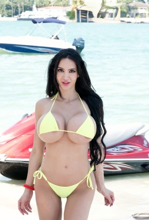Hot curvy Amy Anderssen flaunts enormously round big tits on her jet ski