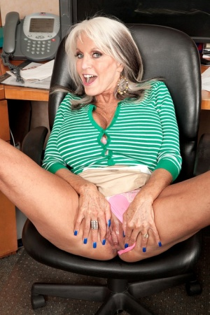 Hot old secretary Sally D'Angelo slides upskirt panties aside to show the pink