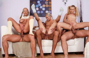 Cute blonde girls of barely legal age do hardcore DPs in groupsex action