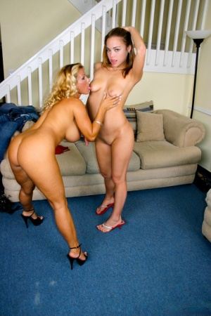 Lesbian women Charity Lane & Holly Halston fuck with assistance from a strapon