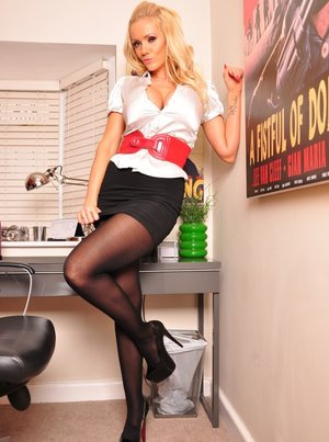 Hot blonde Lucy Zara toys her snatch after stripping down to pantyhose