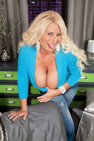 Busty hot mature Annellise Croft in jeans reveals massive melons for a lick 10414120