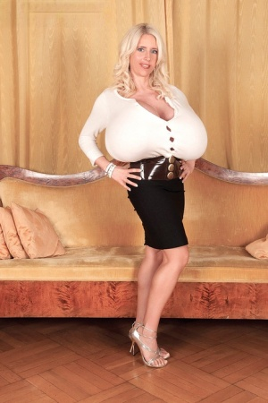 VERY busty MILF Beshine unveils the biggest set of knockers you've ever seen