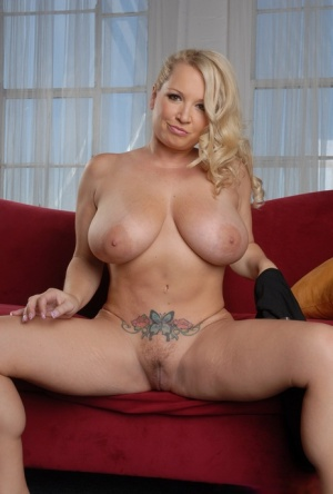 Hot MILF Rachel Love sets her huge boobs free before dildoing her shaved pussy