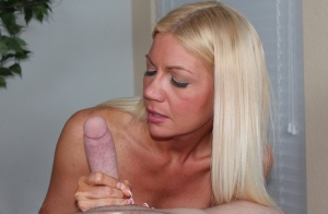 Blue-eyed blonde Christina Skye uncovers large boobs while jerking a long dick