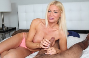 Blond cougar Christina Skye 1 cups her firm tits before giving a handjob