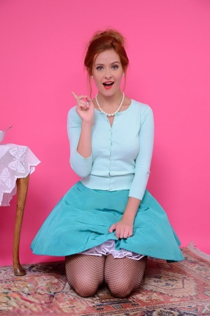 Redhead female Elle Richie removes her clothing with help from vacuum cleaner