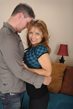 Mature redhead Marissa Vazquez gets stripped by young lover for a cowgirl ride