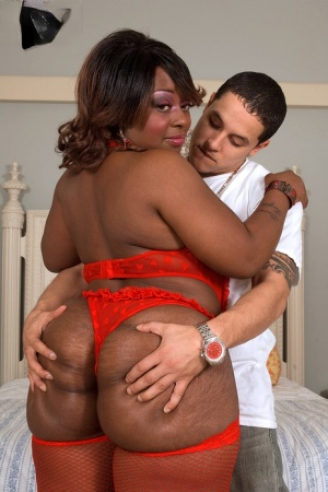 Obese black female Amira Jones gets banged by a white dude in red stockings