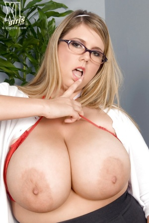 Amazingly sexy bbw in glasses Michelle May puts her humongous boobs on display