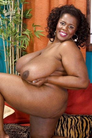 Black fatty Shar Nitzapanus fondling her melons with a toy slipped in her pussy