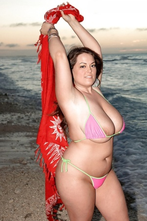 Big titted brunette Taylor Steele stripping from her sexy bikini on the beach