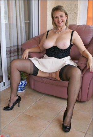 Mature blonde with huge tits posing upskirt and masturbating with a toy