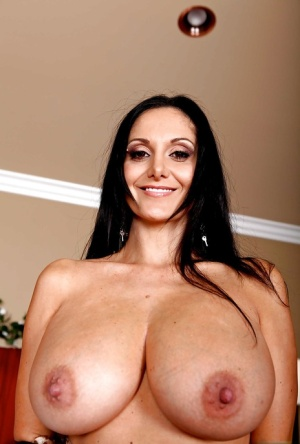Brunette wife Ava Addams showing off huge tits and stretching MILF ass