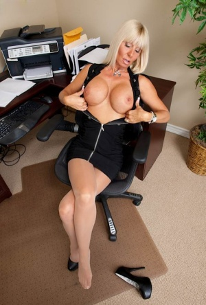 Mature office lady in pantyhose undressing and shoowcasing her goods