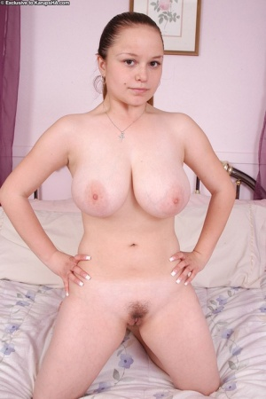 Big busted amateur cutie undressing and showcasing her unshaven gash