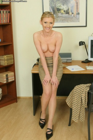 Naughty office lady in glasses and nylons undressing and spreading her pussy