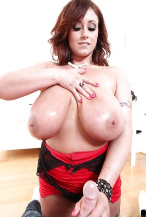 Curvy MILF in glasses gives an oily titjob and takes cum on her huge jugs
