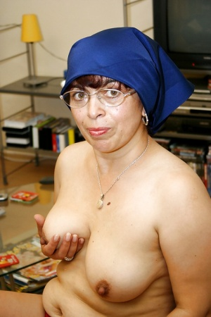 Lusty granny with saggy tits uncovering her fatty curves and shaved cunt