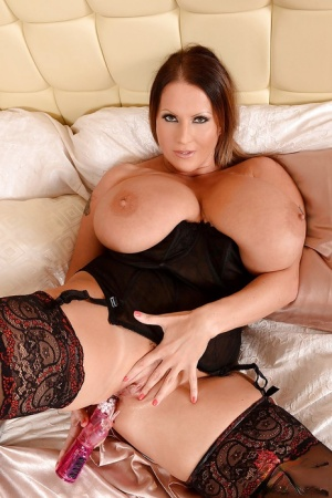 Appetizing fatty with big tits Laura Orsolya is petting her nipples