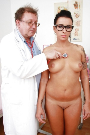 Frisky  brunette cuutie in glasses goes through some unusual gyno procedures