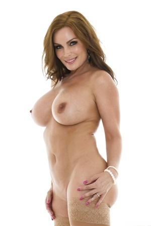 Top-heavy MILF getting nude and spreading her nylon-clad legs