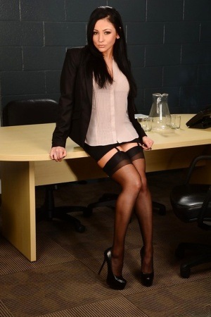 Sultry brunette vixen in stockings slowly uncovering her gorgeous curves