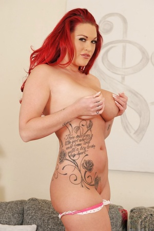 Big tits redhead pornstar Paige Delight is showing her tattoos