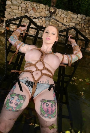 Tattooed babe Hollie Hatton gets tied up hard and drilled outdoors