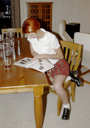 Close up posing of an schoolgirl Lydia West in her kitchen 83750942