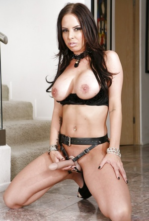 Brunette pornstar Brandy has big sexy tits and a huge strapon