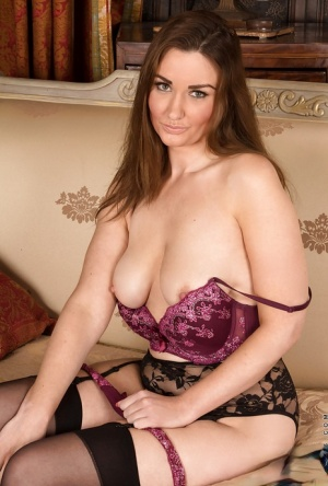Jolly babe Ella Clarke showing boobies and posing in stockings