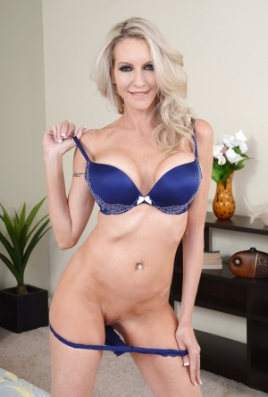 Amazing blonde milf with stunning tits Emma undressing her body