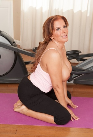 Tattoed milf Nicky Ferrari is doing some amazing stretching workout 28937288