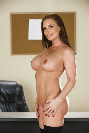Office lady with big boobies Diamond Foxxx is posing in front of her boss