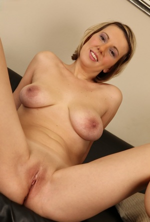 Milf blondie with big tits Luci Angel is masturbating her shaved pussy