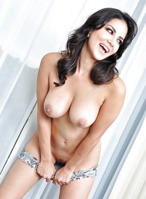 Brunette milf Sunny Leone is revealing her big tits in high heels