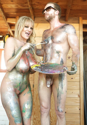 Tattooed amateur milf Kelly Madison is doing handjob to a tattooed guy