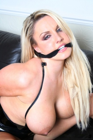 Dannii Harwood is taking part in a sexy posing scene in boots