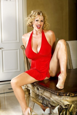 Sexy mature in high heels Kelly Madison takes off her red skirt