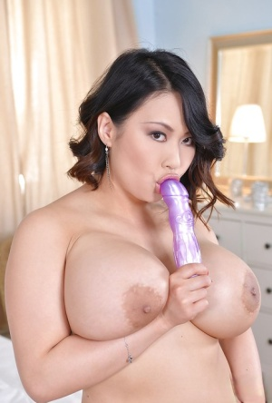 Asian fatty Tiger Benson teases her big tits and her milf pussy